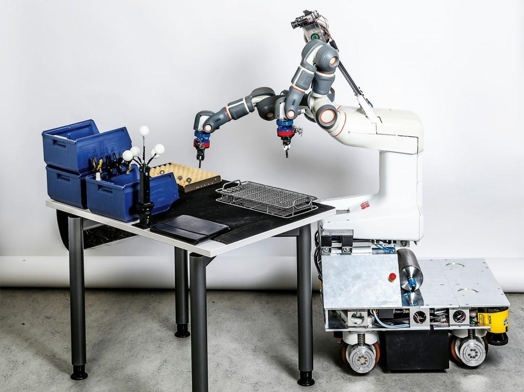 De Prace robot bij het stapelen van metalen onderdelen