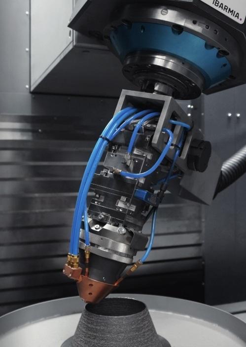Een laserlaskop deponeert het metaal laagje voor laagje